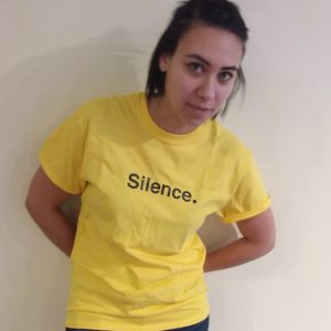 Model wearing yellow Silence. Tee Shirt